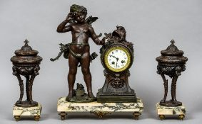 A  three piece clock garniture  Surmounted with cupid, on variegated white marble base.  46 cm high.