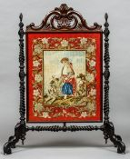 A Victorian tapestry inset carved fire screen Centrally decorated with a couple with a dog.