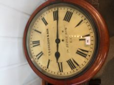 A 19th century mahogany cased fusee dial clock The white dial with Roman numerals inscribed T.S.