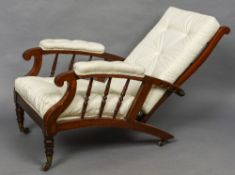 A 19th century walnut framed reclining plantation chair The turned ladder back above the twin