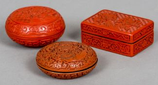 Three Chinese red cinnabar lacquer boxes and covers One rectangular, the others circular,