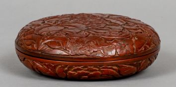 A Chinese red lacquer circular box and cover Worked with floral sprays.  17 cm diameter.