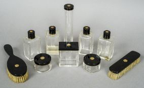 A French Art Deco dressing table set Comprising: various bottles, jars and brushes,