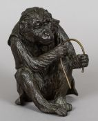 A Japanese Meiji period patinated bronze model of a monkey Modelled seated wearing a florally