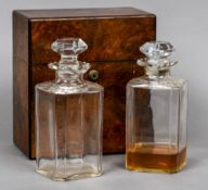 A 19th century burr walnut decanter box The rectangular hinged cover enclosing a pair of cut glass