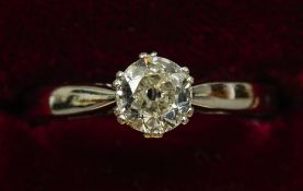 An 18 ct white gold diamond solitaire ring The claw set stone approximately 0.65 carat.