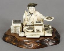 A 19th century carved ivory okimono Formed as a scholarly figure at work,