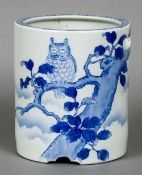 A Chinese blue and white porcelain brush pot The body with pierced handles and decorated with a