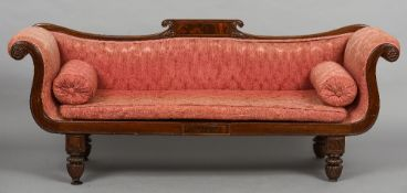 An early 19th century mahogany framed settee The scrolling back with central panelled tablet above