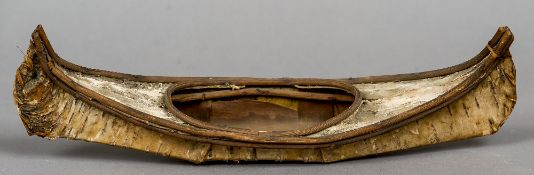 A North American miniature birch bark canoe Of typical form.  30.5 cm long.