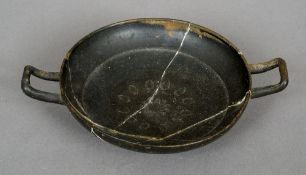 A Roman pottery stemless kylix The interior decorated with anthemion.  25.5 cm wide.
