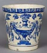 A large 19th century blue and white faience jardiniere Of tapering cylindrical form,