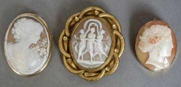 Three cameo brooches Including one carved with the Three Graces, one with an 18 ct gold mount.
