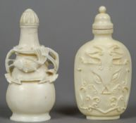 Two Chinese carved ivory snuff bottles One decorated with fish, the other with a mythical beast.