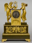 An Empire style gilt bronze figural mantel clock The 3 inch silvered dial with Roman numerals and