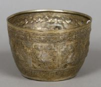 An Indian unmarked white metal bowl Decorated with vignettes of various figures and animals.