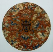 A Chinese embroidered silk roundel Centred with Shau character, framed and glazed.