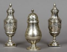 A pair of 19th century Continental silver sifters Each embossed with trailing floral swags;