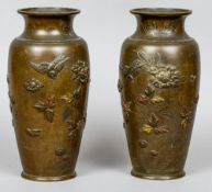 A pair of 19th century Japanese tri-coloured metal bronze vases Typically decorated in the round