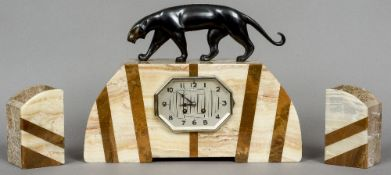 Attributed to MICHEL DECOUX (1837-1924) French An Art Deco bronze mounted onyx cased triple clock
