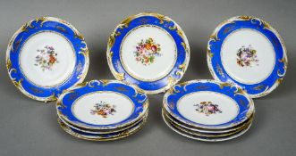Eleven 19th century Limoges porcelain cabinet plates Each centrally painted with floral sprays