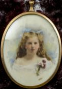 An unmarked yellow metal framed portrait miniature of a young girl Wearing a spray of flowers,
