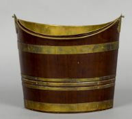 A 19th century mahogany bucket Of navette form, with brass loop handle,