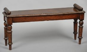 A Victorian mahogany window seat Of rounded rectangular form with twin bolster ends,