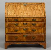 An 18th century walnut bureau The line inlaid fall enclosing a fitted interior with a baize lined