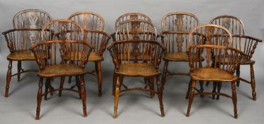A harlequin set eight 19th century yewwood and elm Windsor chairs Each with arched top rail above