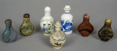 A collection of seven various Chinese porcelain and hardstone snuff bottles The largest 8.5 cm high.