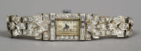 An Art Deco diamond set platinum ladies cocktail watch The rectangular dial with Arabic numerals
