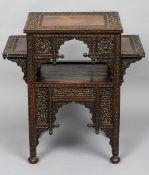 A 19th century Anglo-Indian carved hardwood side table The rectangular top above twin side plinths,