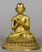 A Sino-Tibetan gilt bronze cast figure of Buddha Modelled seated, signed to base.  16 cm high.