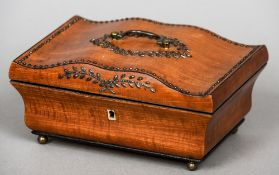 A 19th century satinwood sewing box The hinged serpentine lid inset with polished steel pique