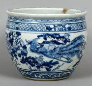 A Chinese blue and white porcelain jardiniere Decorated with a pair of phoenixes interspersed with
