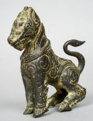 A Chinese archaistic bronze model of a horse Modelled seated, with scrolling decoration.  12.