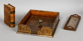 A leather covered desk set Comprising: paper tray, pen tray and a book form box.
