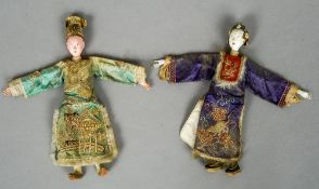 Two 19th century Chinese Imperial dolls Each with hand painted face and embroidered silk costume.