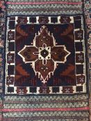 A Caucasian wool rug The midnight blue field enclosing a central  medallion within geometric border