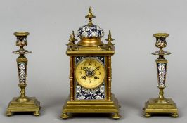 A French gilt metal and champleve triple clock garniture The gilt dial with Arabic numerals signed