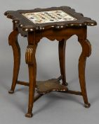 A late 19th century specimen marble inlaid games table The shaped top inset with a marble panel