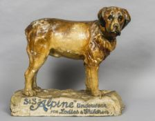 An early 20th century papier mache advertising figure Formed as a St.
