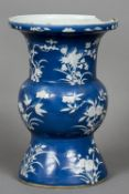 A Chinese porcelain vase Decorated with fruiting and floral sprays on a blue ground.  33.5 cm high.