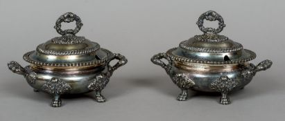 A pair of silver plated twin handled tureens and covers Each of oval form,