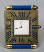 A Cartier Paris enamel decorated brass folding travel clock 5.5 cm wide.