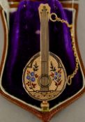 An enamel decorated 18 ct gold watch Formed as a mandolin,