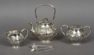 A Chinese silver three piece tea set Comprising: a teapot,