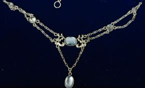 An unmarked silver Arts & Crafts necklace Set with moonstones.  39.5 cm long.