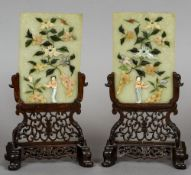 A pair of Chinese jade and hardstone table screens Each decorated with a female figure amongst